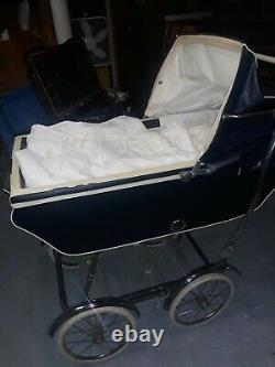 1950s Rex stroller with canopy blue with white trim chrome wheels